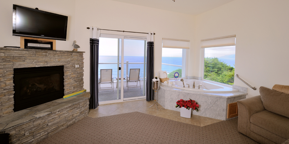 soak in your marble tub as you look out onto the Pacific.